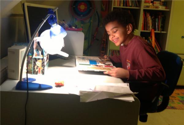 A boy reading at a desk